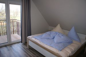 Schlafzimmer vom King Size Appartement auf dem Bauernhof Lange in der Gemeinde Ummanz auf Rügen